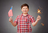 Boy with benghal light and American flag — Stock Photo