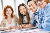 Smart groupmates  at lesson — Stock Photo