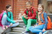 Schoolkids after school — Stock Photo