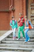 School friends going down stairs — Foto de Stock