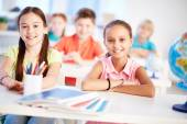 Adorable girls at lesson — Stock Photo