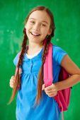 Schoolgirl with backpack — Stock Photo