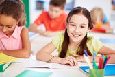 Little girl at lesson — Stock Photo