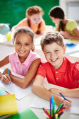 Two schoolkids  drawing — Stock Photo