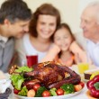 Thanksgiving roasted turkey and family — Stock Photo #55472735