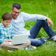Man and his son networking outdoors — Stock Photo #55473181