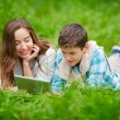 Woman and son using digital tablet outdoors — Stock Photo #55473353