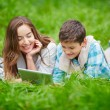Woman and son networking outdoors — Stock Photo #55473357