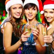 Girls in Santa caps toasting — Stock Photo #55474409