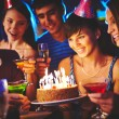 Girl looking at birthday cake — Stock Photo #55475921