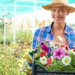 Female with petunias — Stock Photo #55477871