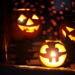 Jack-o-lanterns in a window — Stock Photo #55479869