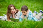 Woman and son using digital tablet outdoors — Stock Photo