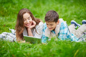 Woman and son networking outdoors — Stockfoto