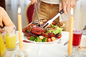 Roasted poultry on festive table — Stock Photo