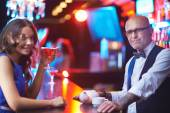 Man in eyeglasses and girl with drink — Stock Photo