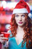 Girl in Santa cap with glass of martini — Stock Photo