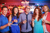 People with drinks  at party — Stock Photo