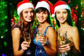 Cheerful girls  at Christmas party — Stock Photo