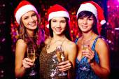 Girls in Santa caps — Stock Photo