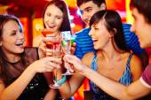 Friends with flutes of sparkling champagne — Foto de Stock