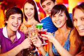 Guys and girls toasting — Stock Photo