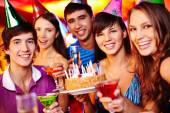 Friends with birthday cake — Stock Photo
