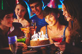 Girl looking at birthday cake — Stockfoto