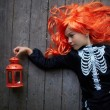 Girl in red wig and Halloween costume — Stock Photo #55484251