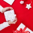 Gift boxes, Santa cap and decorative toy star — Stock Photo #55486883