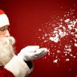 Santa Claus blowing snow — Stock Photo #55487075