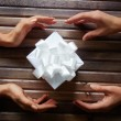 Hands giving box with Christmas present — Stock Photo #55487577