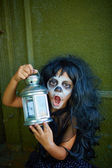 Spooky girl with lantern — Stock Photo