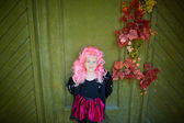 Girl wearing Halloween attire and pink wig — Stock Photo