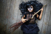 Halloween girl with broom — Stock Photo