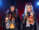 Halloween girls with lanterns — Stock Photo