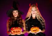 Halloween witches with pumpkins — Stock Photo