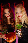 Halloween women toasting with cocktails — Stock Photo