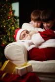 Santa Claus sleeping and two boys — Stock Photo