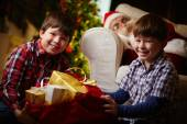 Boys with sack of presents — Stock Photo