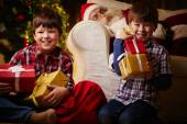 Happy boys with gift boxes — Stock Photo
