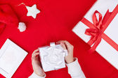 Gift boxes, Santa cap and toy star — Stock Photo
