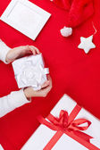 Gift boxes, Santa cap and decorative toy star — Foto de Stock
