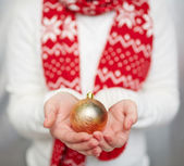 Golden toy ball on palms — Foto Stock