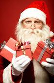 Santa Claus with gift boxe — Stock Photo