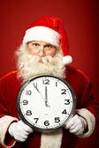 Santa Claus holding clock — Stock Photo
