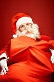 Santa Claus with gigantic sack — Stock Photo