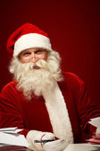 Santa with letters — Stock Photo