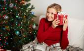 Curious female with red gift box — Foto Stock