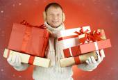 Man holding gift boxes — Stock Photo